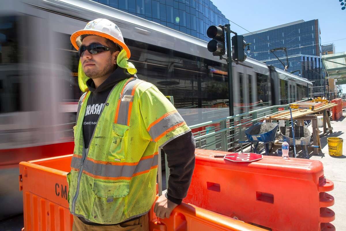 Tobias Vasquez, laborer, navigates pedestrian traffic around soon functioning Muni stop outside the Chase Center. Any ticket to Chase Center Warriors games, concerts, or any other events will automatically include a ticket to ride on Muni at no additional cost. On Tuesday, July 23, 2019. San Francisco, Calif.