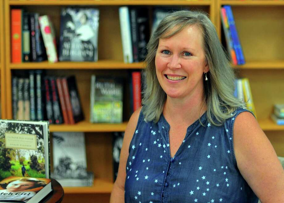 Shelton resident and author Amanda Marrone poses at Turning The Page in Monroe. She is going to be at Turning the Page at 1 p.m. July 27 to launch her new middle grade book, Salem's Lost Story of Tituba's Daughter. Photo: Christian Abraham / Hearst Connecticut Media / Connecticut Post