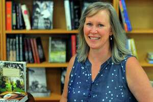 Shelton resident and author Amanda Marrone poses at Turning The Page in Monroe. She is going to be at Turning the Page at 1 p.m. July 27 to launch her new middle grade book, Salem's Lost Story of Tituba's Daughter.