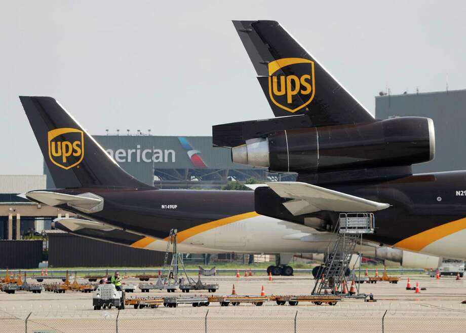 In this June 24, 2019, photo workers prepare to unload a UPS aircraft after it arrived at Dallas-Fort Worth International Airport in Grapevine, Texas. United Parcel Service Inc. announced that starting Jan. 1 it will offer pickup and delivery services seven days a week, adding service on Sundays. (AP Photo/Tony Gutierrez) Photo: Tony Gutierrez / Copyright 2019 The Associated Press. All rights reserved.