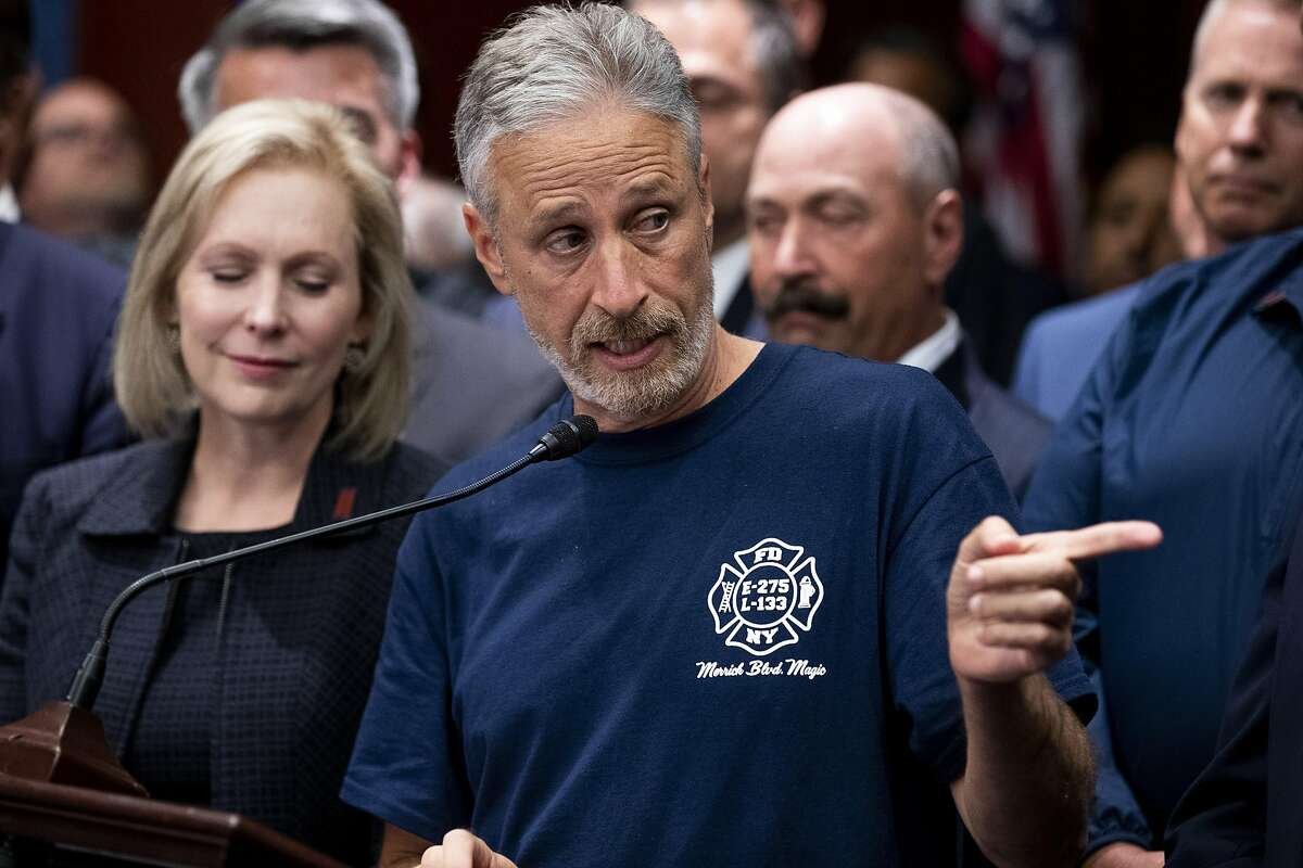 The comedian Jon Stewart speaks at a news conference with Sept. 11 emergency workers after passage of legislation to extend aid to Sept. 11 emergency workers on Capitol Hill in Washington, July 23, 2019. Congress on Tuesday gave final approval to legislation that would extend lifetime compensation to emergency workers who became ill after the attacks. (Anna Moneymaker/The New York Times)
