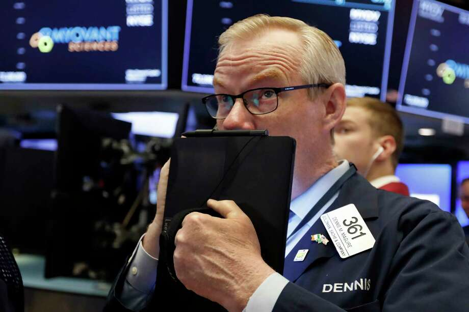 FILE - In this Thursday, July 18, 2019, file photo trader Dennis Maguire works on the floor of the New York Stock Exchange. The U.S. stock market opens at 9:30 a.m. EDT on Tuesday, July 23. (AP Photo/Richard Drew, File) Photo: Richard Drew / Copyright 2019 The Associated Press. All rights reserved.