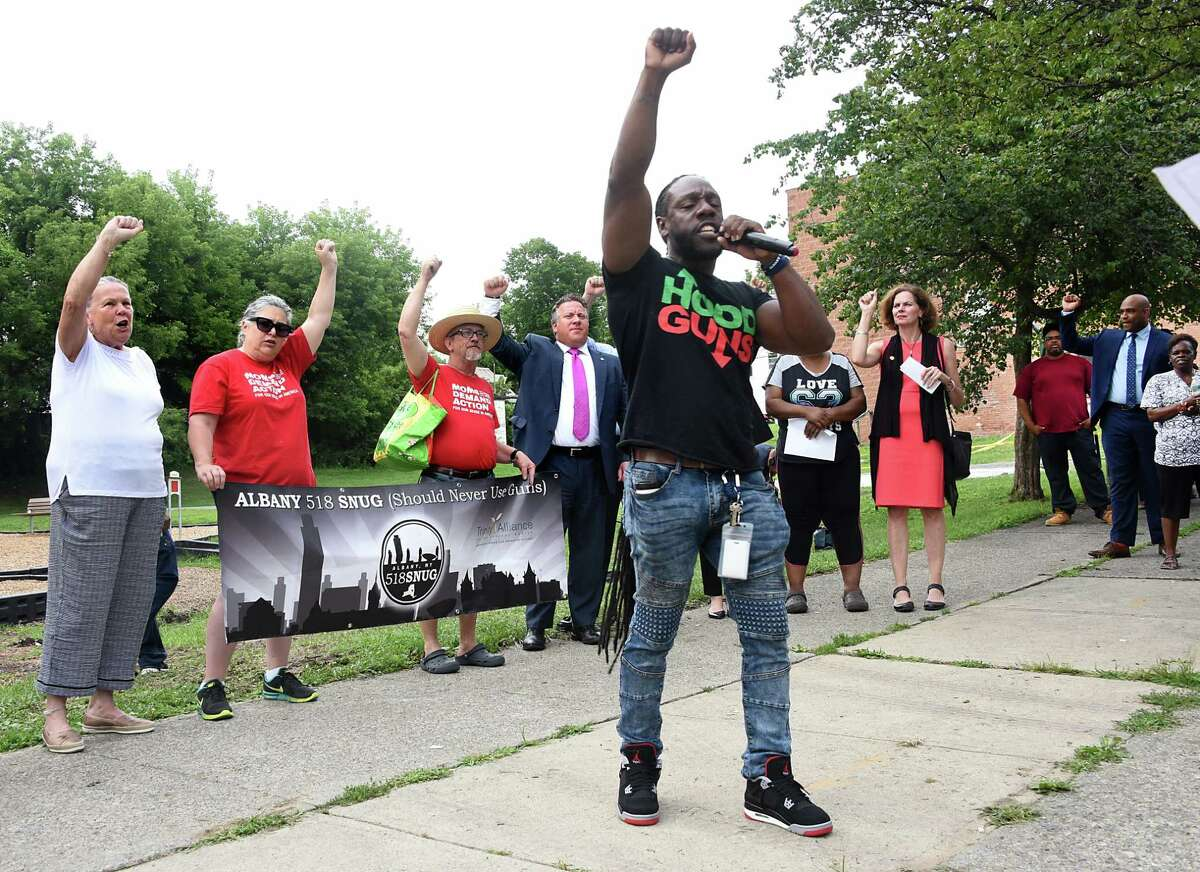 Shawn Floss Cooks, outreach worker with 518 SNUG, leads chants as anti-violence activists hold a rally at Third Avenue and Elizabeth Street near where a sleeping child was hit with a stray bullet last week on Tuesday, July 23, 2019 in Albany, N.Y. Albany 518 SNUG organized the gathering. (Lori Van Buren/Times Union)
