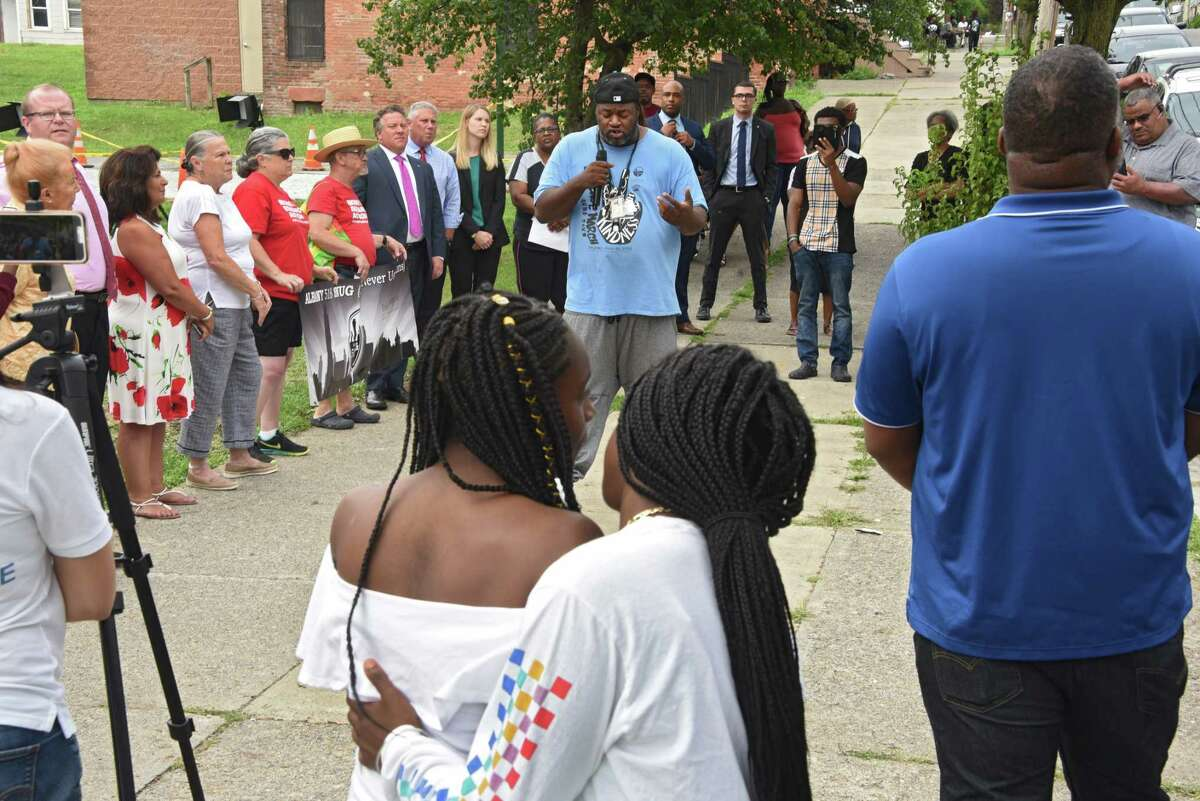 Richard Williams of 518 SNUG speaks as anti-violence activists hold a rally at Third Avenue and Elizabeth Street near where a sleeping child was hit with a stray bullet last week on Tuesday, July 23, 2019 in Albany, N.Y. Albany 518 SNUG organized the gathering. (Lori Van Buren/Times Union)