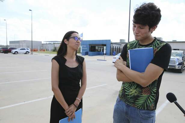 U.S. citizen Francisco Galicia, 18, chats with his attorney, Claudia Galan, after his release from the South Texas Detention Facility in Pearsall, Texas after being held since June 27 after a stop at a checkpoint near Falfurrias. His attorney, Claudia Galan of McAllen, arrived on Tuesday, July 23, 2019 to present the necessary paperwork for his release and while talking with media on the scene, ICE officials released Galicia from the facility in the same clothing he wore when he was stopped. Galicia fielded questions and then placed a call to his mother before Galan accompanied the young man back home. (Kin Man Hui/San Antonio Express-News)