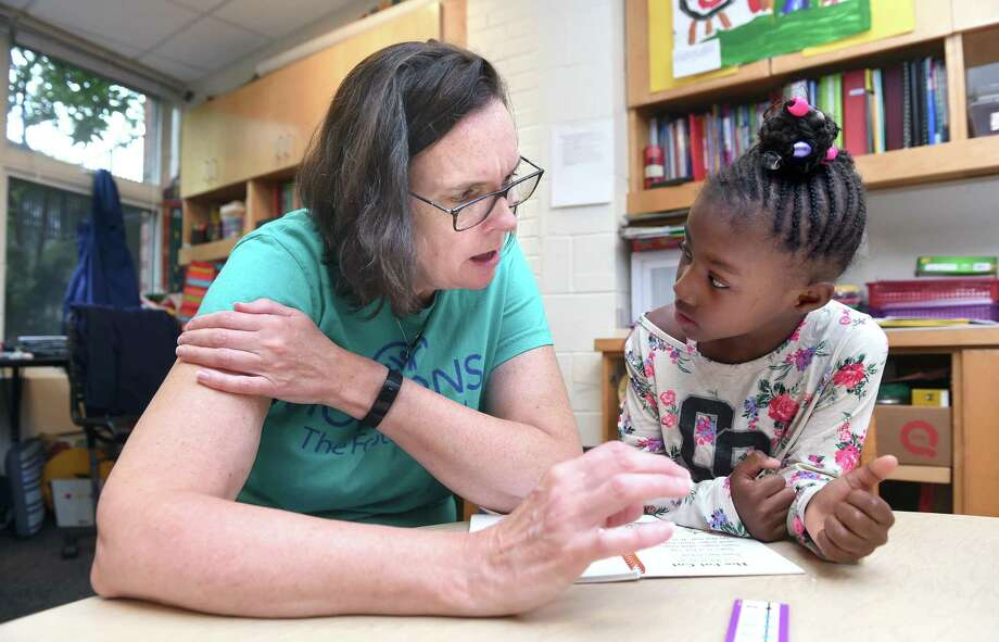 Sue Shaw, left, helps kindergartner Hajile Sloan, 6, with reading at Horizons at Foote in New Haven on July 23, 2019. Photo: Arnold Gold / Hearst Connecticut Media / New Haven Register