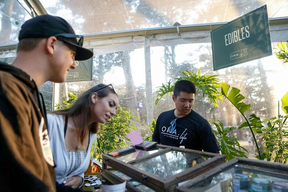 (Left to Right) Mitch Smith and Taryn Lee ask Mark Wong about edibles in the Grass Lands area at Outside Lands Music Festival on Saturday, August 11, 2018 in San Francisco, Calif. Photo: Amy Osborne / Special To The Chronicle 2018