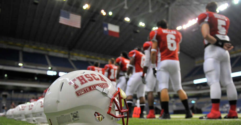 Players for the South All-Stars line up before the Texas High School Coaches Association All-Star game at the Alamodome Tuesday evening. Photo: Robin Jerstad/For The Express-News