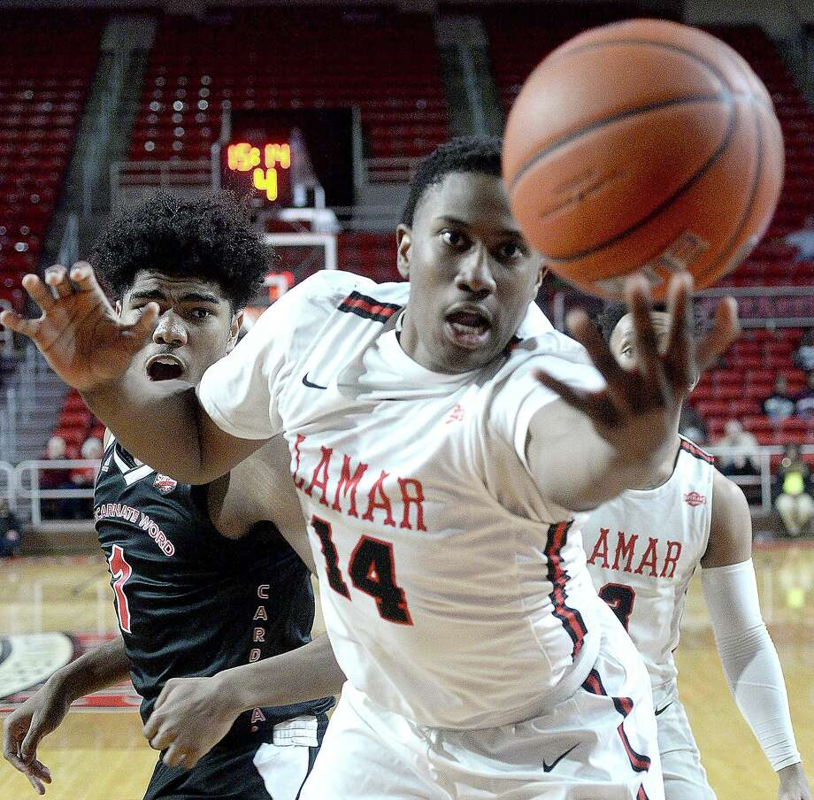 Lamar's Edwin Jeudy tries to keep the ball inbounds against Incarnate Word during their Southland Conference match-up Wednesday at the Montagne Center.  Photo taken Wednesday, January 23, 2019  Photo by Kim Brent/The Enterprise Photo: Kim Brent / The Enterprise / BEN