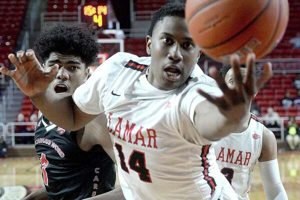 Lamar's Edwin Jeudy tries to keep the ball inbounds against Incarnate Word during their Southland Conference match-up Wednesday at the Montagne Center. Photo taken Wednesday, January 23, 2019 Photo by Kim Brent/The Enterprise