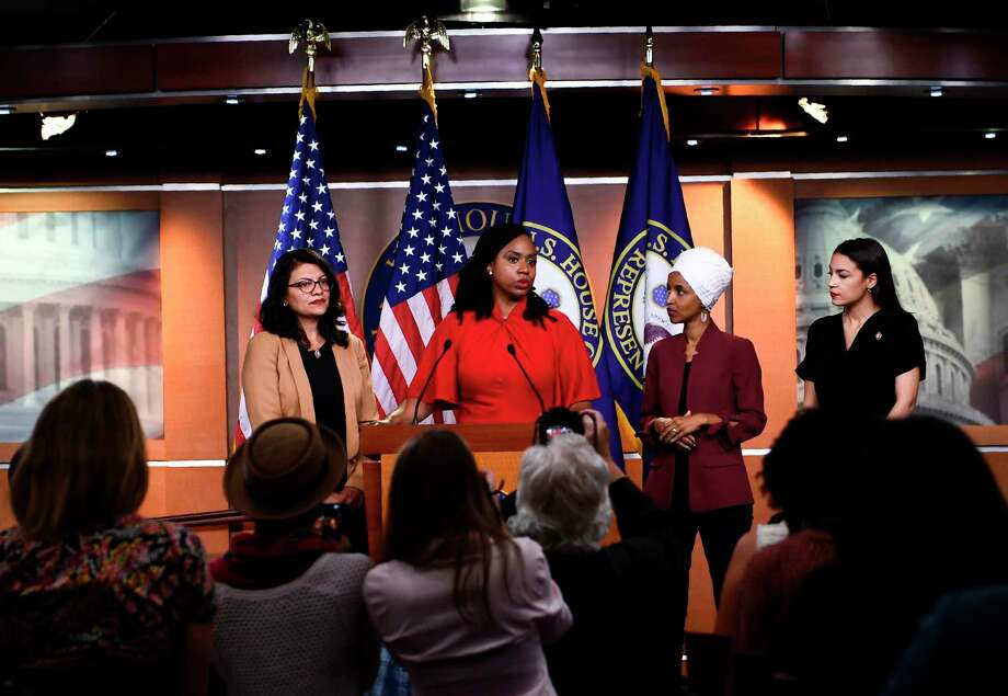 "(FILES) In this file photo taken on July 15, 2019 US Representatives Ayanna Pressley (D-MA) speaks as, Ilhan Omar (D-MN)(2R), Rashida Tlaib (D-MI) (R), and Alexandria Ocasio-Cortez (D-NY) look on during a press conference, to address remarks made by US President Donald Trump earlier in the day, at the US Capitol in Washington, DC. - US President Donald Trump renewed attacks on July 21, 2019 on four Democratic congresswomen he launched xenophobic tweets against last week, demanding they apologize ""for the horrible (hateful) things they have said."" ""I don't believe the four Congresswomen are capable of loving our Country,"" Trump tweeted of ethnic-minority first-term Democrats Alexandria Ocasio-Cortez, Rashida Tlaib, Ilhan Omar and Ayanna Pressley.""They should apologize to America (and Israel) for the horrible (hateful) things they have said. They are destroying the Democrat Party, but are weak & insecure people who can never destroy our great Nation!"" the president tweeted. (Photo by Brendan Smialowski / AFP)BRENDAN SMIALOWSKI/AFP/Getty Images Photo: BRENDAN SMIALOWSKI / AFP/Getty Images / AFP or licensors"