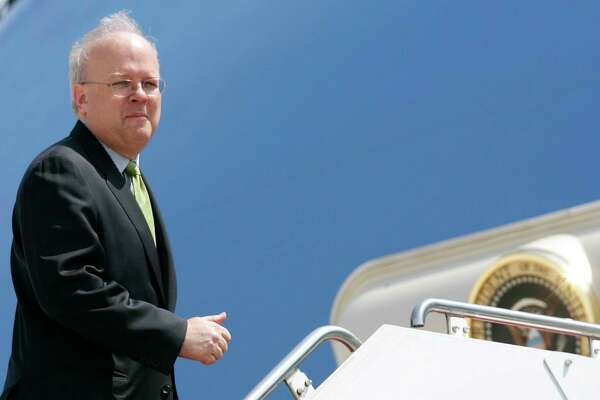Outgoing White House Deputy Chief of Staff Karl Rove walks up the stairs to Air Force One at Andrews Air Force Base in Mary;and, Monday, Aug. 13, 2007. (AP Photo/Evan Vucci)
