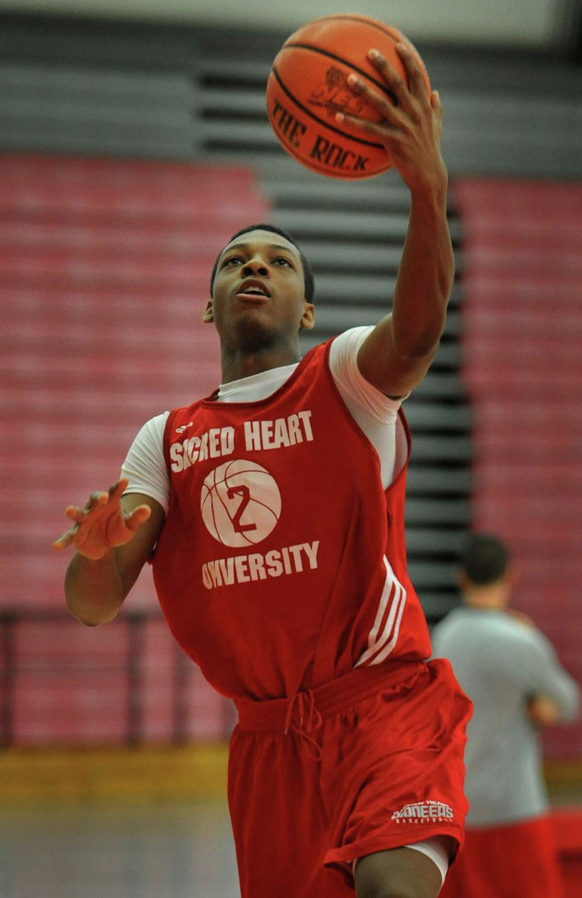 Sacred Heart University's Evan Kelly of Norwalk drives in for a lay-up during basketball practice at the Pitt Center.