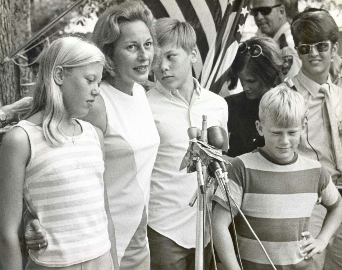 Joan Aldrin, wife of astronaut Buzz Aldrin, speaks to the media after the successful splashdown of the Apollo 11 capsule on July 24, 1969. Joan Aldrin and her children, from left, Janice, Michael and Andrew, held a hot but happy post-splashdown press conference.