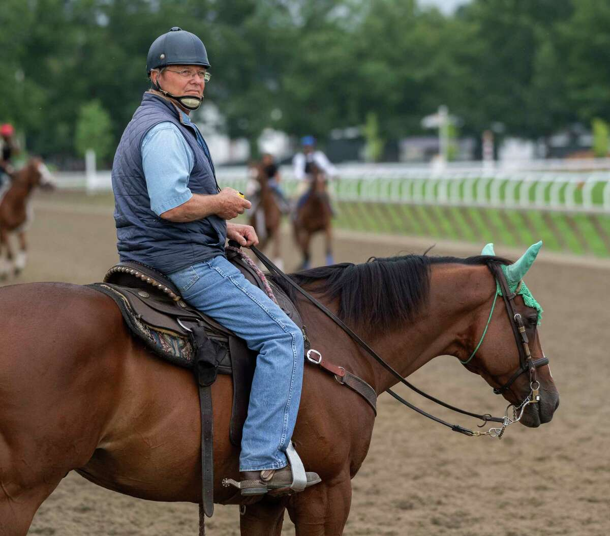 Trainer Bill Mott watches his horses working on the Oklahoma Training Center Track July 22, 2019 in Saratoga Springs, N.Y. Photo special to the Times Union by Skip Dickstein