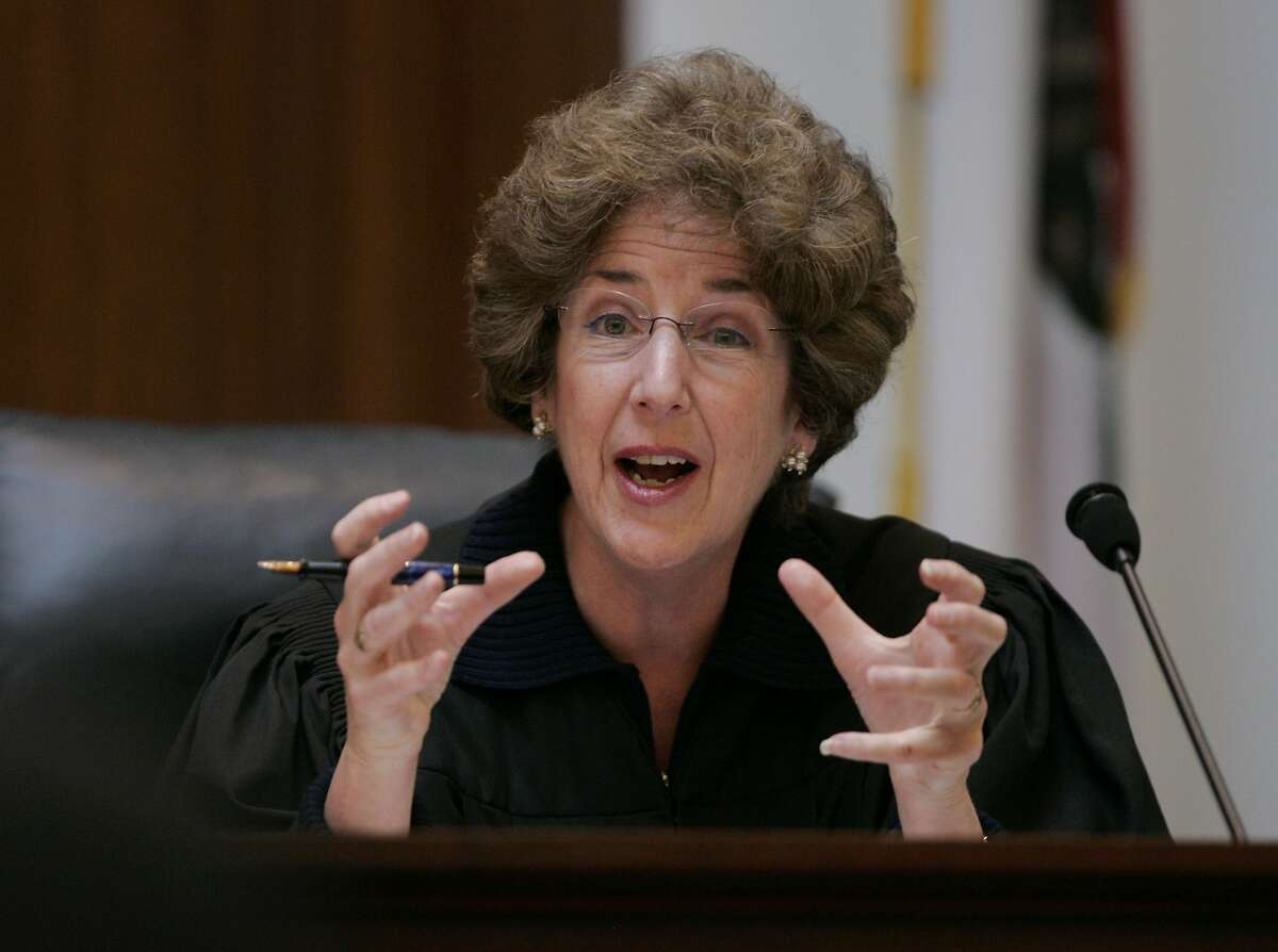California Supreme Court Associate Justice Carol A. Corrigan gestures towards a presenter in San Francisco, Tuesday, March 4, 2008. Gay marriage supporters and opponents finished presenting arguments on whether California should join Massachusetts in legalizing same-sex marriages. The court heard more than 3 hours of arguments Tuesday in six separate cases being heard jointly. The seven justices asked whether California already protects the civil rights of gay and lesbian couples through domestic partnerships. (AP Photo/Paul Sakuma, pool)