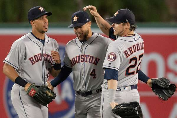 Astros outfielders, from left, Michael Brantley, George Springer and Josh Reddick celebrate a July 18 road win over the Angels.