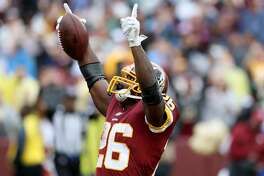 LANDOVER, MD - SEPTEMBER 23: Adrian Peterson #26 of the Washington Redskins celebrates after rushing for a first half touchdown against the Green Bay Packers at FedExField on September 23, 2018 in Landover, Maryland. (Photo by Rob Carr/Getty Images)