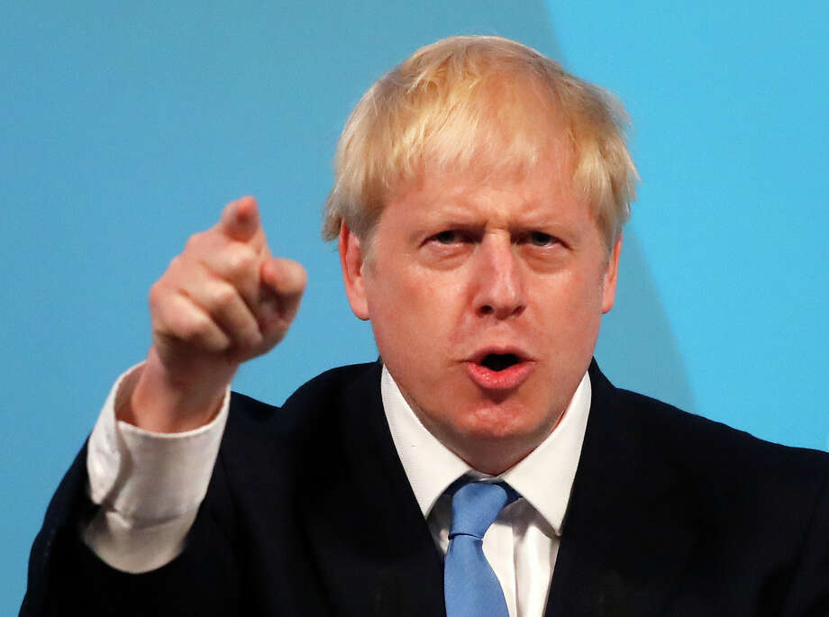 Boris Johnson gestures as he speaks after being announced as the new leader of the Conservative Party in London, Tuesday, July 23, 2019. Brexit champion Boris Johnson won the contest to lead Britain's governing Conservative Party on Tuesday, and will become the country's next prime minister. (AP Photo/Frank Augstein) Photo: Frank Augstein / Copyright 2019 The Associated Press. All rights reserved