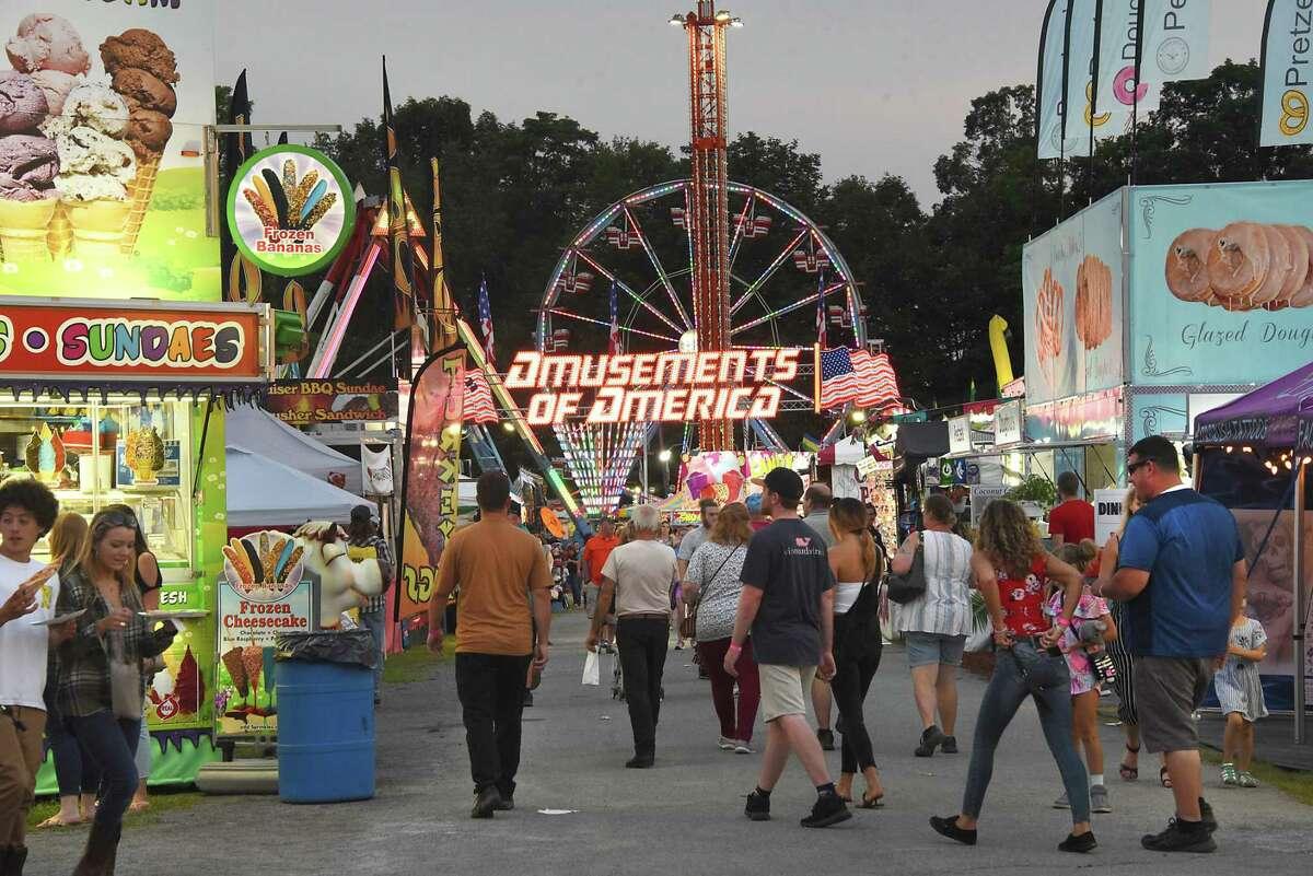 People walk around the food vendor area during the 178th Saratoga County Fair on Tuesday, July 23, 2019 in Ballston Spa, N.Y. (Lori Van Buren/Times Union)