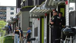 A strong police presence centered around two apartments in the Ida Yarbrough Apartments complex on Tuesday, July 23, 2019, in Albany, N.Y.  (Will Waldron/Times Union)