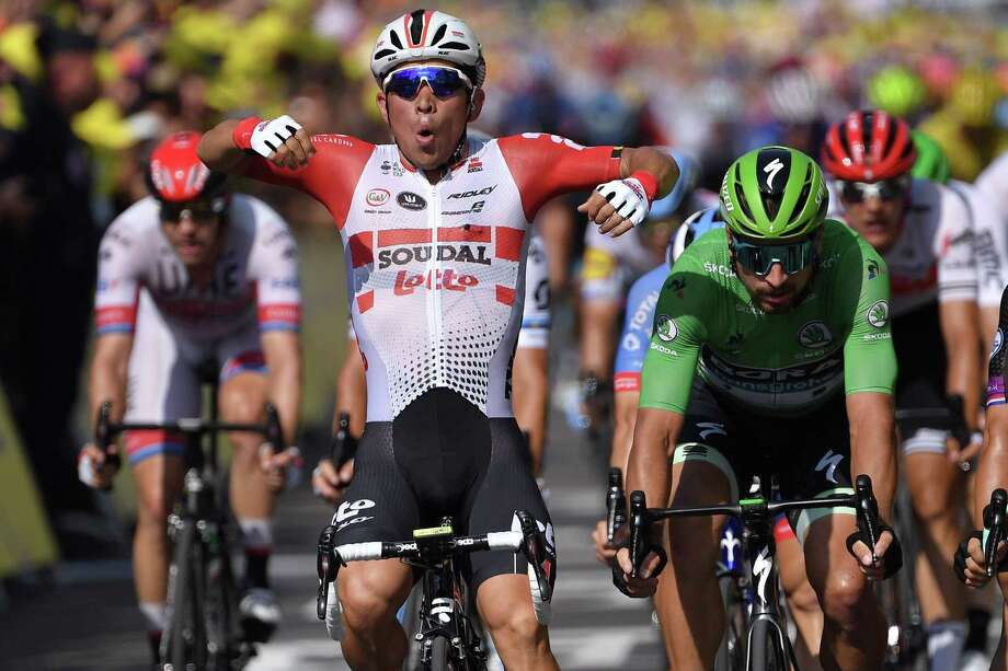 Australia's Caleb Ewan (L) celebrates, past Slovakia's Peter Sagan, wearing the best sprinter's green jersey, as he wins on the finish line of the sixteenth stage of the 106th edition of the Tour de France cycling race between Nimes and Nimes, in Nimes, on July 23, 2019. (Photo by Marco Bertorello / AFP)MARCO BERTORELLO/AFP/Getty Images Photo: MARCO BERTORELLO / AFP or licensors