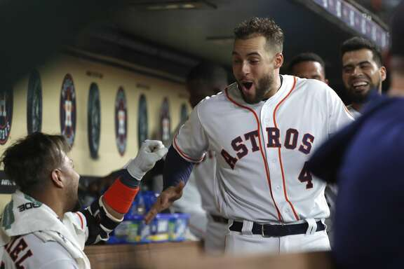 Houston Astros Yuli Gurriel (10) celebrates with George Springer (4) after his two-run inside-the-park home run during the second inning of an MLB baseball game at Minute Maid Park, Tuesday, July 23, 2019.