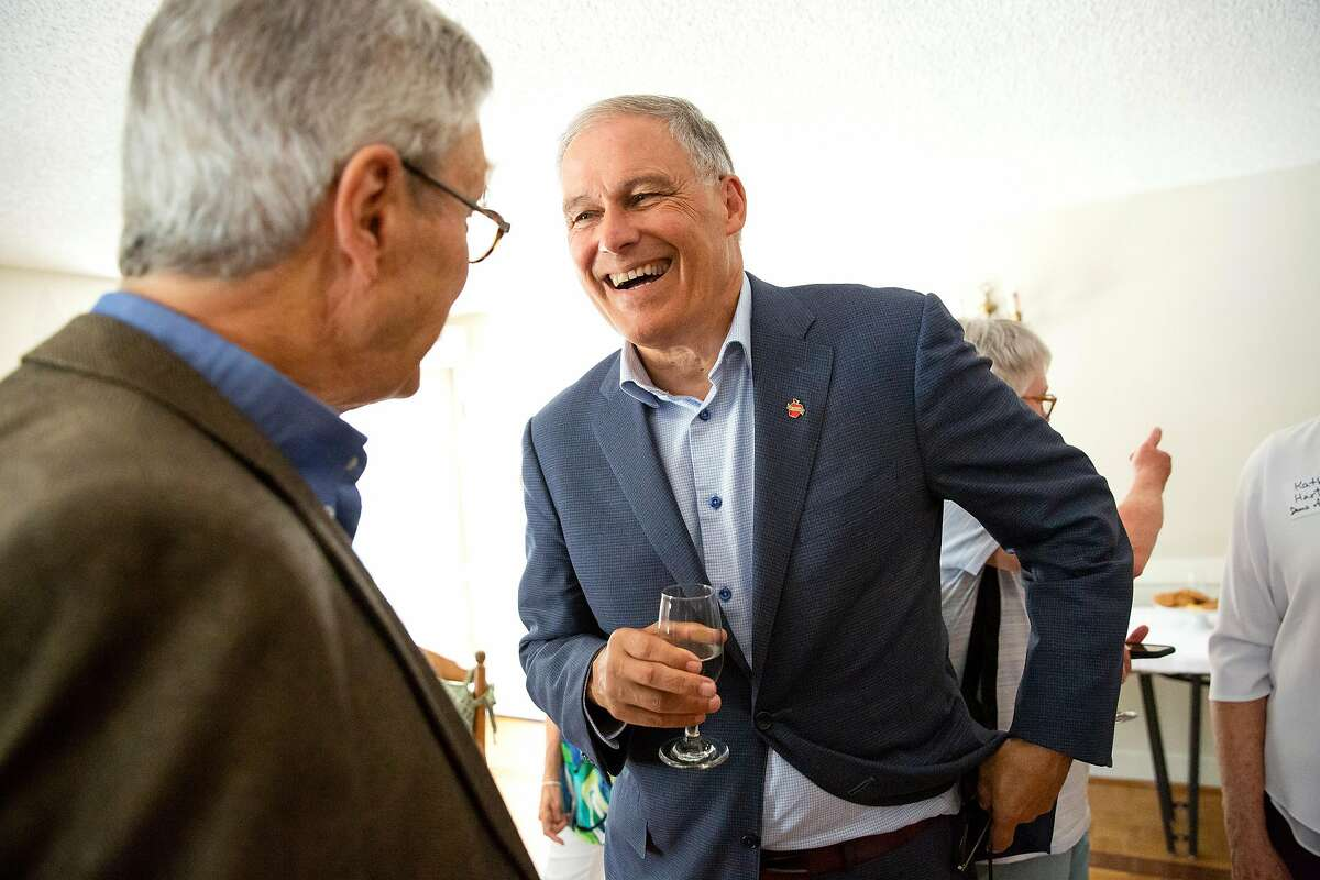 Washington Gov. Jay Inslee, a long shot candidate for president, speaks individual Rosmoor residents prior to the speaking engagement for the Rossmoor Democratic Club in Walnut Creek, Calif. on Tuesday, July 23, 2019.