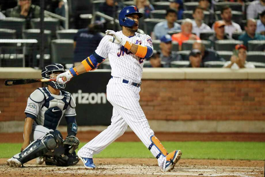 New York Mets' Robinson Cano watches his solo home run during the fourth inning of a baseball game against the San Diego Padres, Tuesday, July 23, 2019, in New York. San Diego Padres catcher Francisco Mejia is behind the plate. (AP Photo/Kathy Willens) Photo: Kathy Willens / Copyright 2019 The Associated Press. All rights reserved.