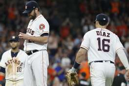 Houston Astros starting pitcher Wade Miley (20) waits for manager AJ Hinch to come get him off the mound during the ninth inning of an MLB baseball game at Minute Maid Park, Tuesday, July 23, 2019.