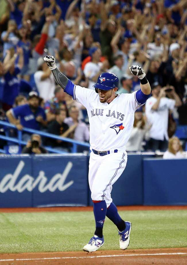 TORONTO, ON - JULY 23:  Eric Sogard #5 of the Toronto Blue Jays scores the game winning run on a single by Justin Smoak #14 in the tenth inning during a MLB game against the Cleveland Indians at Rogers Centre on July 23, 2019 in Toronto, Canada.  (Photo by Vaughn Ridley/Getty Images) Photo: Vaughn Ridley / 2019 Getty Images