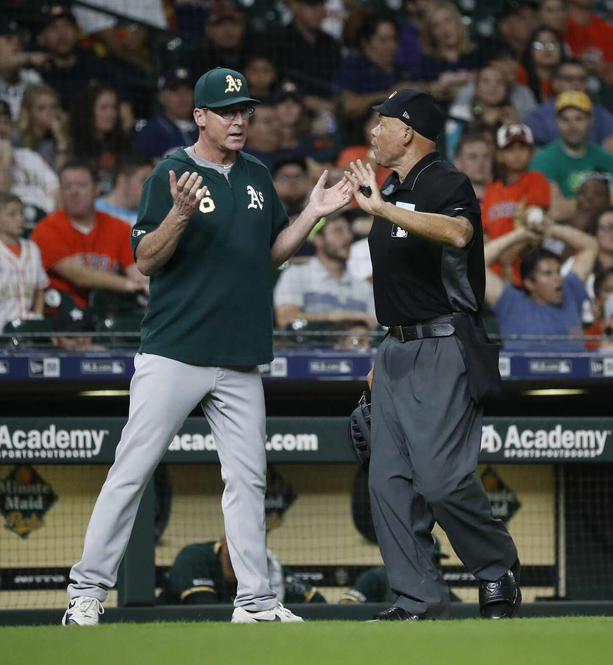 Oakland Athletics manager Bob Melvin (6) argues with home plate umpire Kerwin Danley after Ramon Laureano hit a ground-rule double during the eleventh inning of an MLB baseball game at Minute Maid Park, Tuesday, July 23, 2019.