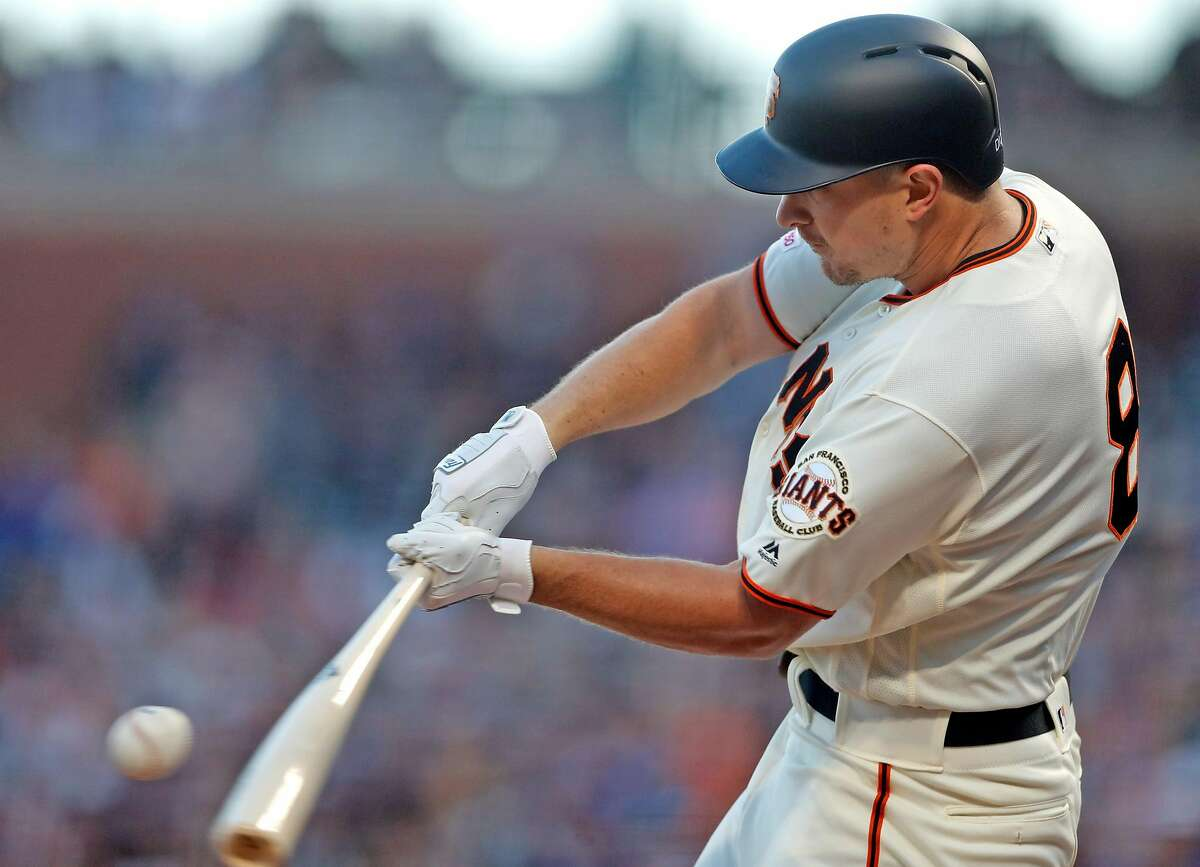 San Francisco Giants' Alex Dickerson hits a solo home run in 4th inning against Chicago Cubs during MLB game at Oracle Park in San Francisco, Calif., on Tuesday, July 23, 2019.