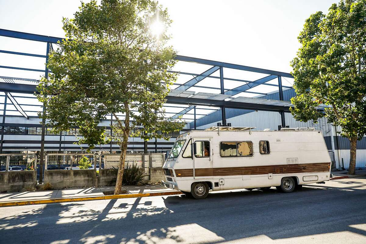 Chris Castle parks his RV after disposing of garbage in Berkeley, California, on Tuesday, July 23, 2019.