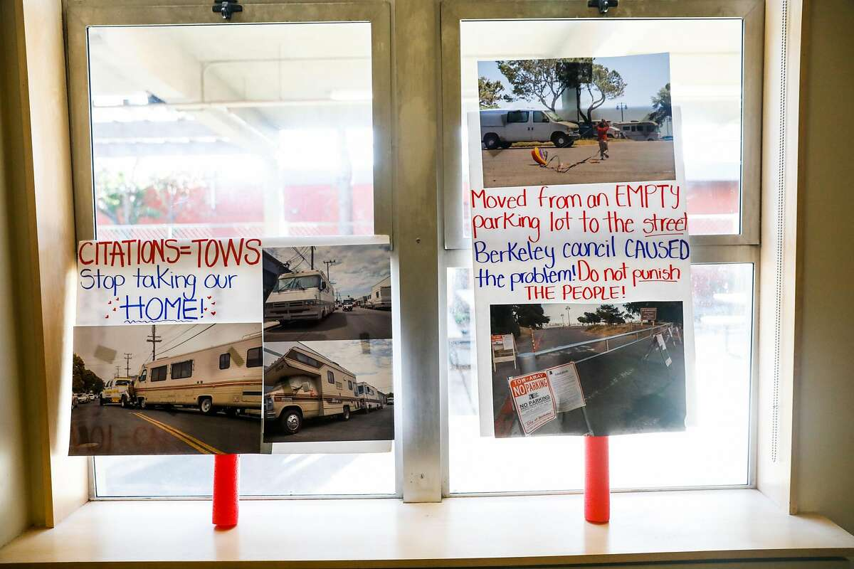 Signs that support RV's are seen resting against a window during a Berkeley city council meeting in Berkeley, California, on Tuesday, July 23, 2019.