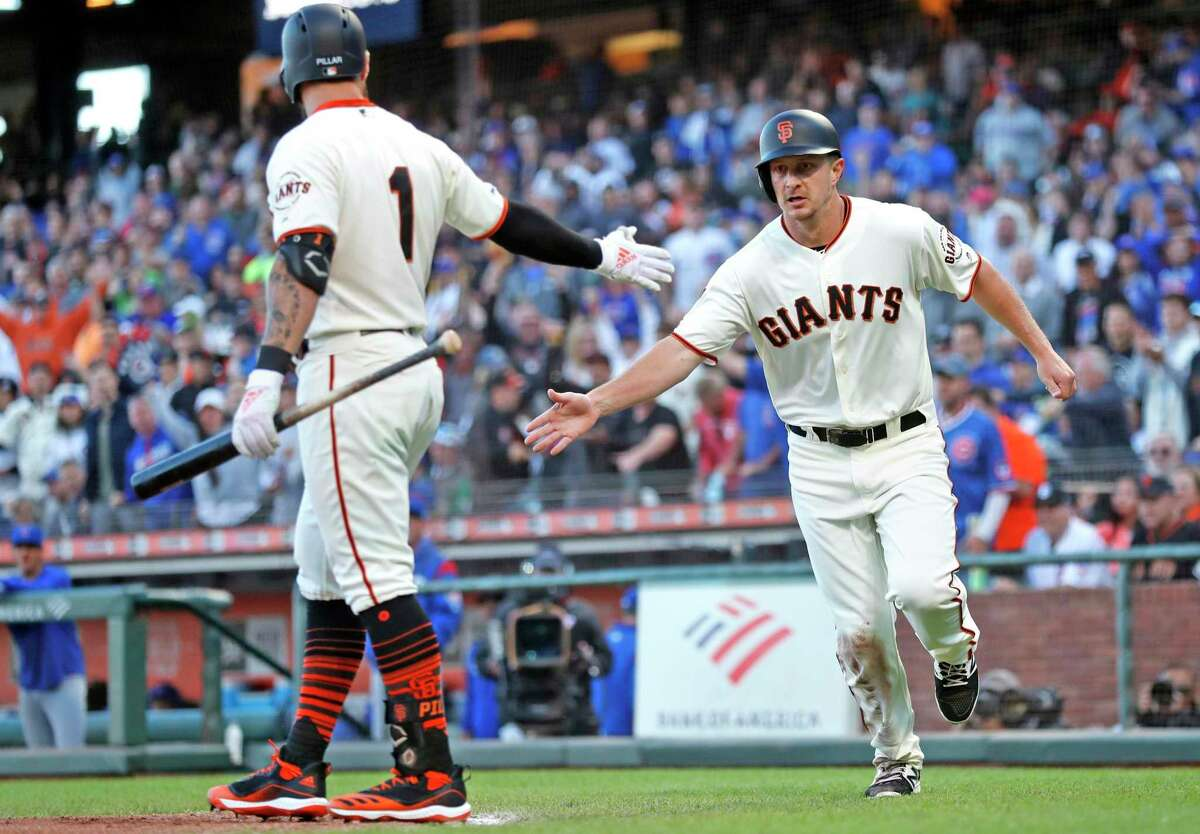 San Francisco Giants' Alex Dickerson scores on a Mike Yastrzemski sacrifice fly in 2nd inning against Chicago Cubs during MLB game at Oracle Park in San Francisco, Calif., on Tuesday, July 23, 2019.