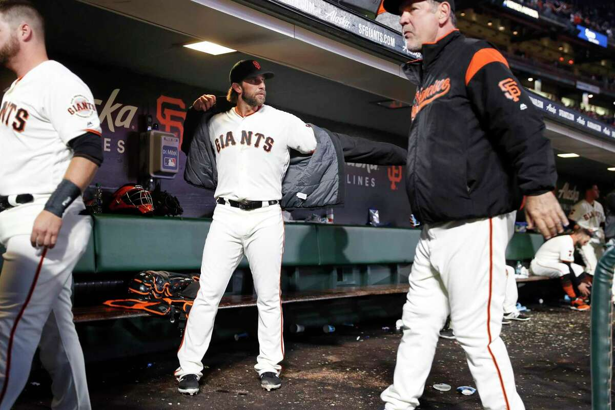 San Francisco Giants' Madison Bumgarner and Bruce Bochy in dugout after Bumgarner's 7 innings of pitching against Chicago Cubs during MLB game at Oracle Park in San Francisco, Calif., on Tuesday, July 23, 2019.