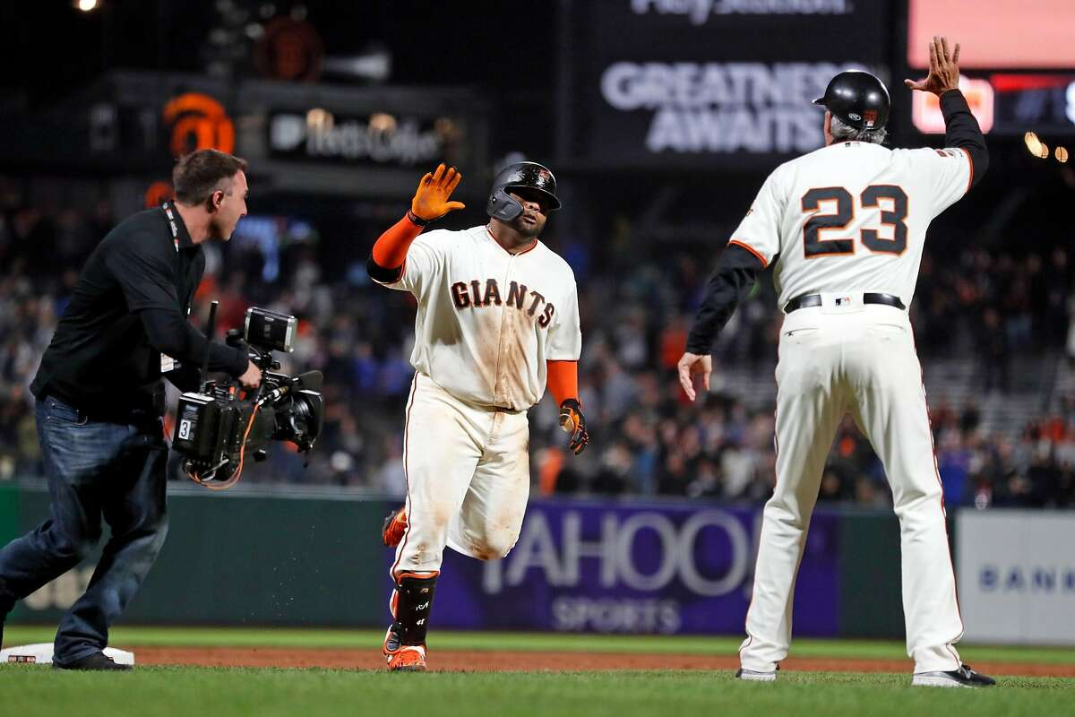San Francisco Giants' Pablo Sandoval rounds third base after his walk off home run in 13th inning of 5-4 win over Chicago Cubs during MLB game at Oracle Park in San Francisco, Calif., on Tuesday, July 23, 2019.