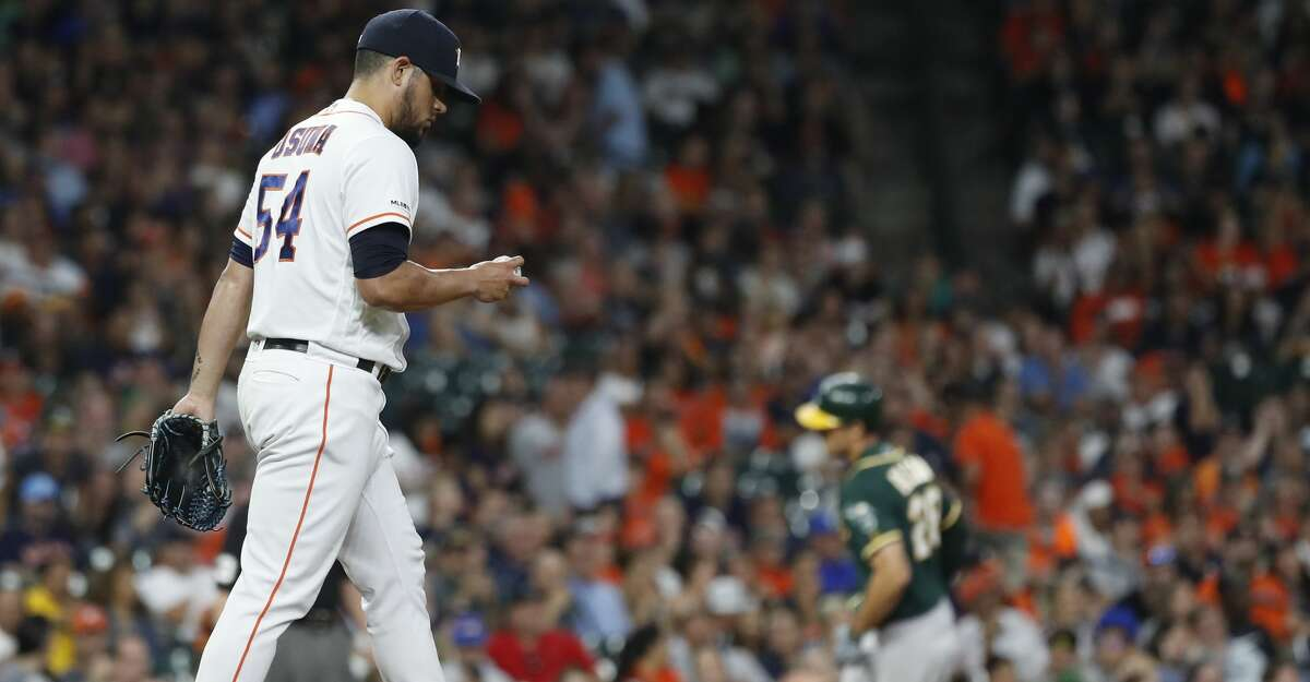 Houston Astros relief pitcher Roberto Osuna (54) reacts after giving up a three-run home run to Oakland Athletics Matt Olson (28) during the ninth inning of an MLB baseball game at Minute Maid Park, Tuesday, July 23, 2019.