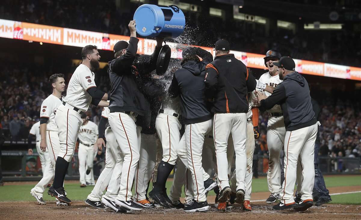 San Francisco Giants players celebrate after Pablo Sandoval hit a solo home run during the 13th inning of a baseball game against the Chicago Cubs in San Francisco, Tuesday, July 23, 2019. The Giants won 5-4 in 13 innings. (AP Photo/Jeff Chiu)