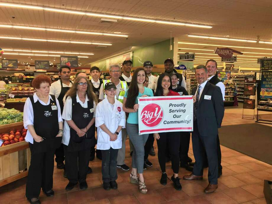 The staff of Big Y on Hawley Lane recently gave a $5,000 donation to the Connecticut Fallen Heroes Foundation. Volunteers Cara Ann Cama, left, and Rachel Mastroni, right. along with Store Director Joe Fetcho, far right, are pictured here with store employees. The Connecticut Fallen Heroes Foundation is a non-profit, all-volunteer, organization which is based in Trumbull. The group distributes portraits, sculptures and handmade quilts to the Gold Star families of Connecticut, Rhode Island, New York, Massachusetts, and Maryland. The foundation was founded following the 2005 death of PFC Cheyenne Seymour of Trumbull. It all started in 2005 with the tragic death of 18 year old soldier, PFC Cheyenne M. Seymour of Trumbull. Photo: Fallen Heroes Foundation / Contributed Photo / Trumbull Times Contributed