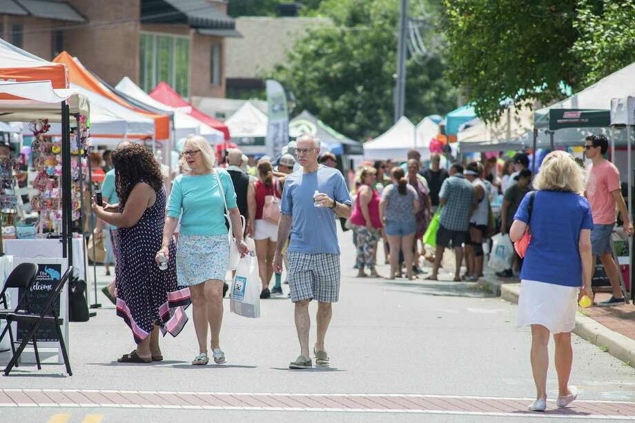 Crowds of shoppers braved the hot weather to check out last year's street fair on July 20. Photo: Bryan Haeffele / Hearst Connecticut Media / Wilton Bulletin