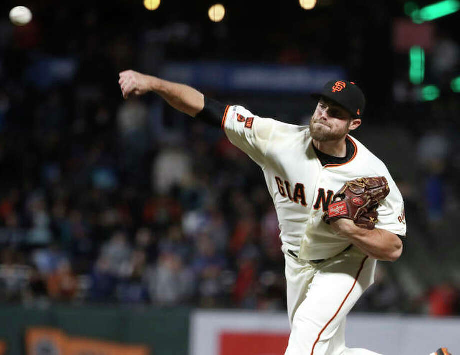 Giants pitcher Sam Coonrod throws against the Chicago Cubs during the 13th inning Tuesday night in San Francisco. Coonrod, from Carrollton, picked up his first major-league win with a perfect inning of relief in the Giants' 5-4 victory. Photo: AP Photo