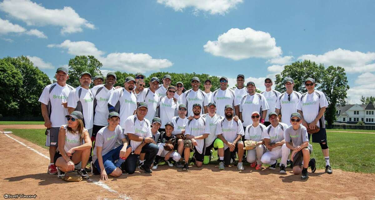 Bernie Williams' Breathless All-Stars pose for a team photo at Ridgefield's Governor Park on July 13.