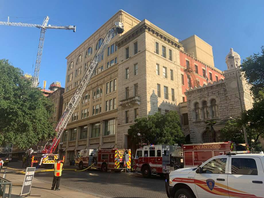 A fire at a hotel temporarily closes East Commerce Street and West Crockett Street Wednesday morning. Photo: Priscilla Aguirre