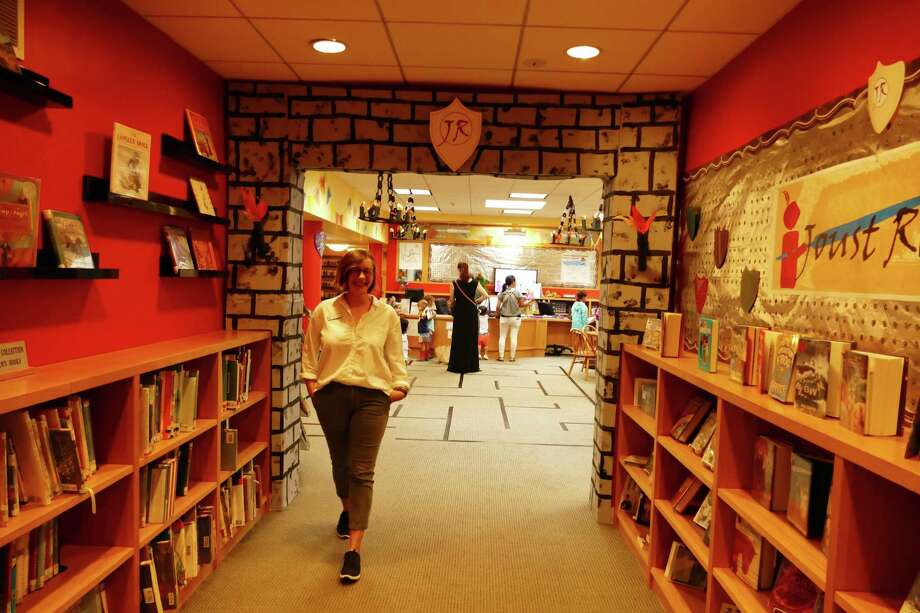 Marie Aspinwall walks out the entrance of the children's room at the New Canaan Library that has been decorated for the very popular Joust Read program. She told the Advertiser on July 18. 2019 about the unprecedented attendance for summer reading. Photo: Grace Duffield / Connecticut Post