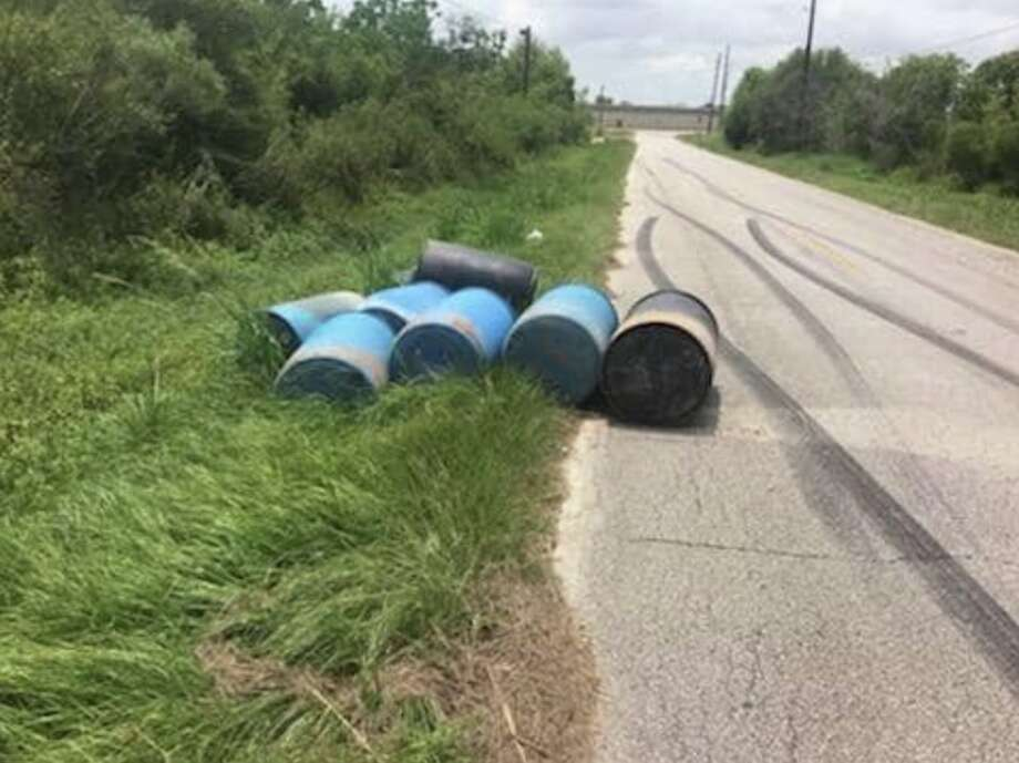 Barrels containing more than 200 gallons of sulfuric acid are seen along Bauer Road on Tuesday, July 23, 2019. Photo: Harris County Precinct 1 Constable's Office