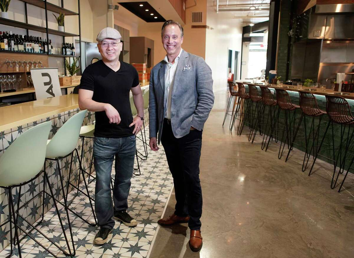 Anh Mai, left, and Shepard Ross, right, are partners in Bravery Chef Hall at Aris Market Square, 409 Travis.