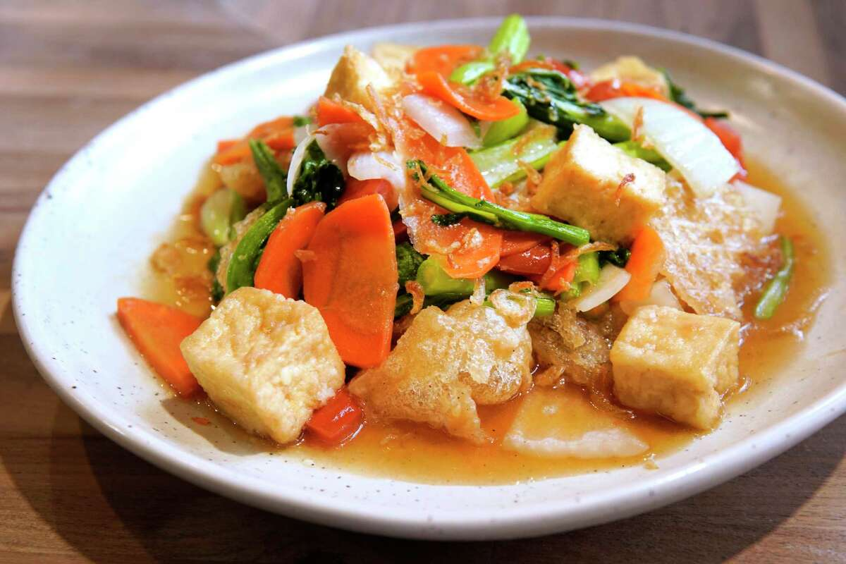 A dish of puffed rice noodles with tofu from The Blind Goat in Bravery Chef Hall in Aris Market Square, 409 Travis. The Blind Goat is chef Christine Ha's first restaurant.