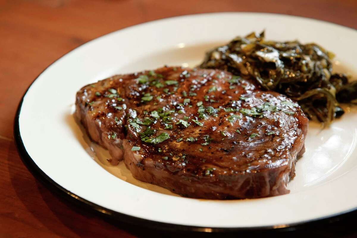The Gulf and Ranch dish with creamed greens at Cherry Block in Bravery Chef Hall, a new food hall in downtown Houston.